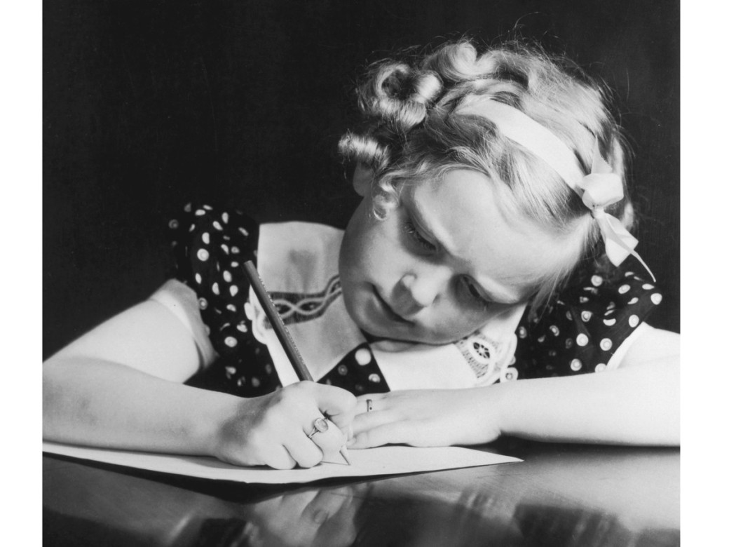 young-girl-writing-a-letter-gettyimages-51310702